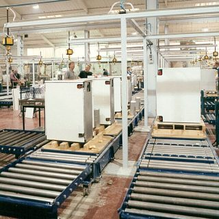 Image of a factory with people