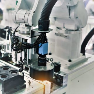 Robotic machine vision system in phone factory